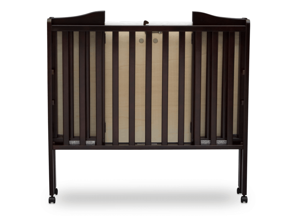 Delta Children Portable Mini Crib in brown folded on wheels front view