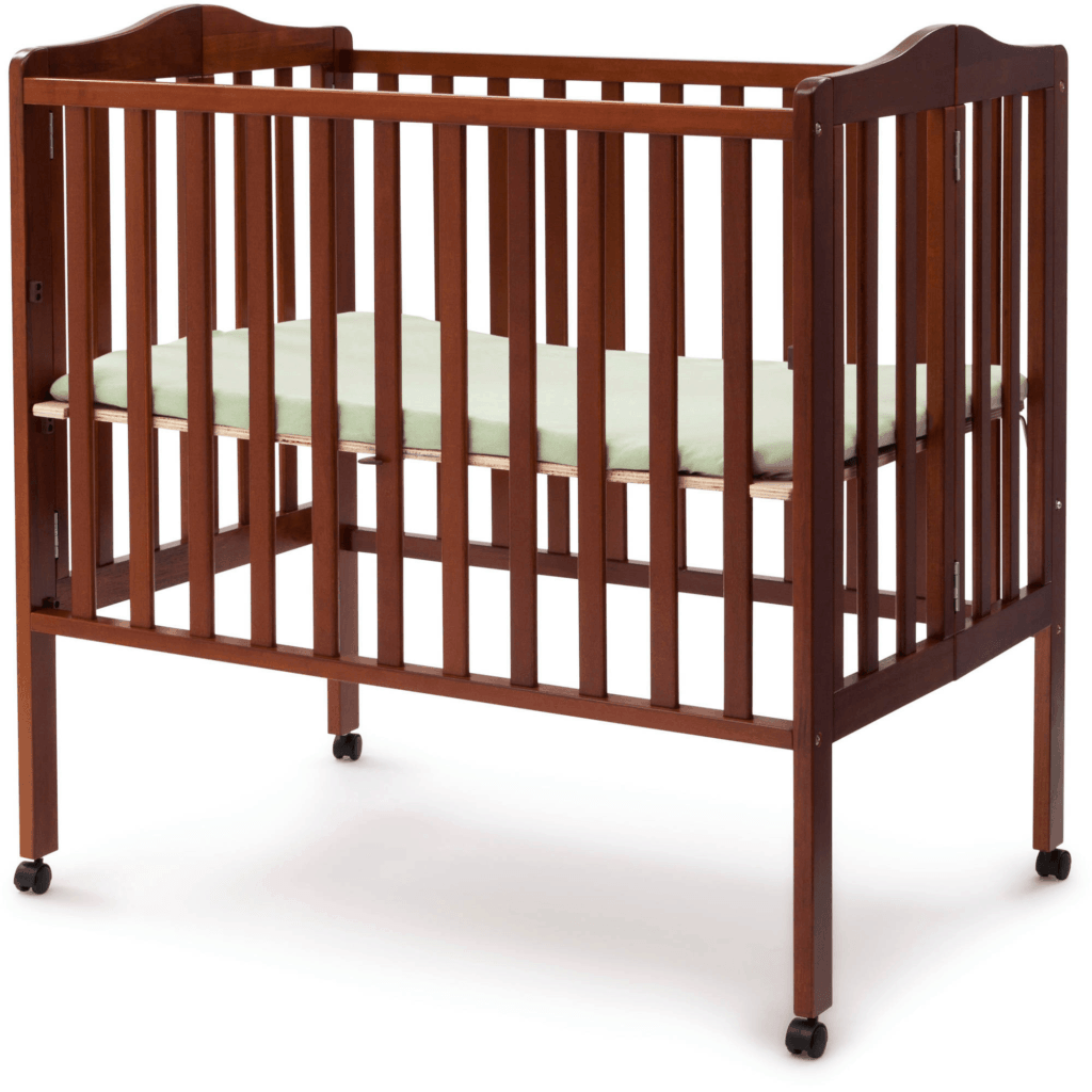 Delta Children Portable Mini Crib in cherry open on wheels in higher height setting for infants