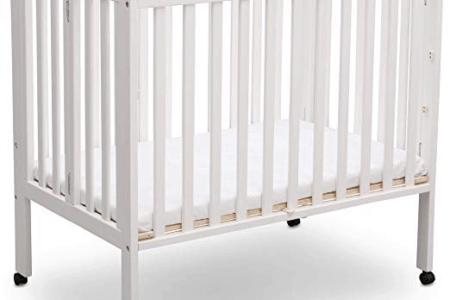 Delta Children Portable Mini Crib in white open on wheels