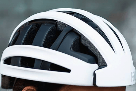 Fend helmet in white worn by person showing side view