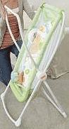 Fisher-Price Rock-n-Play Portable Bassinet in lime green folding up