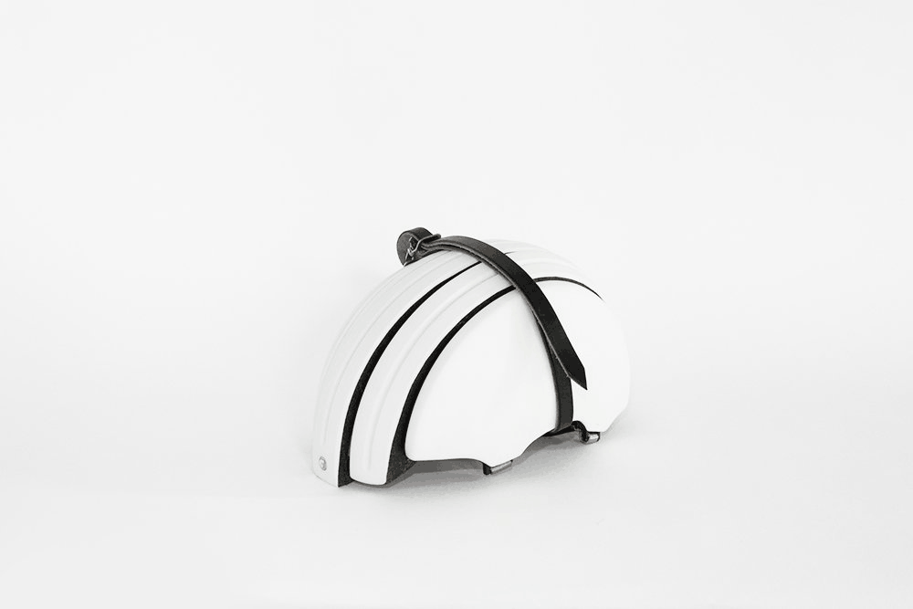 Brooks England Carrera in white collapsed wrapped in black leather strap