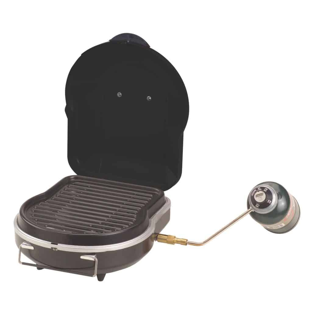 Coleman Fold-N-Go Grill in black open with propane tank attached