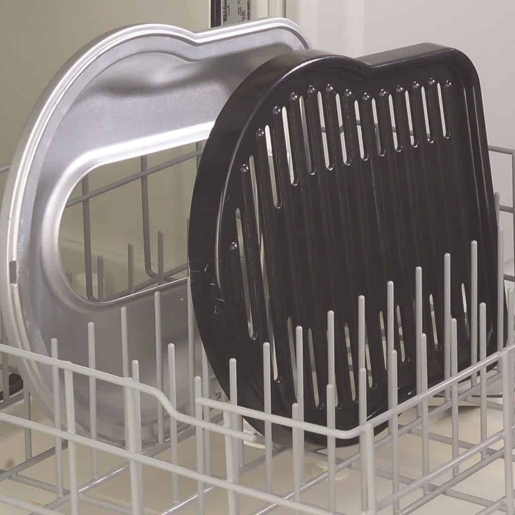 Coleman Fold N Go grill parts on dishwasher rack
