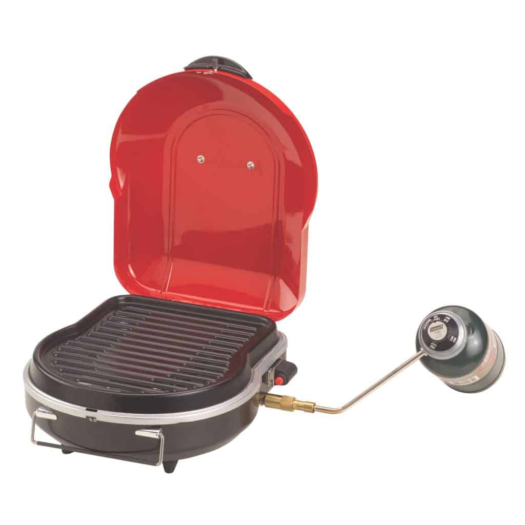 Coleman Fold-N-Go+ Instastart Grill in red open with propane tank attached