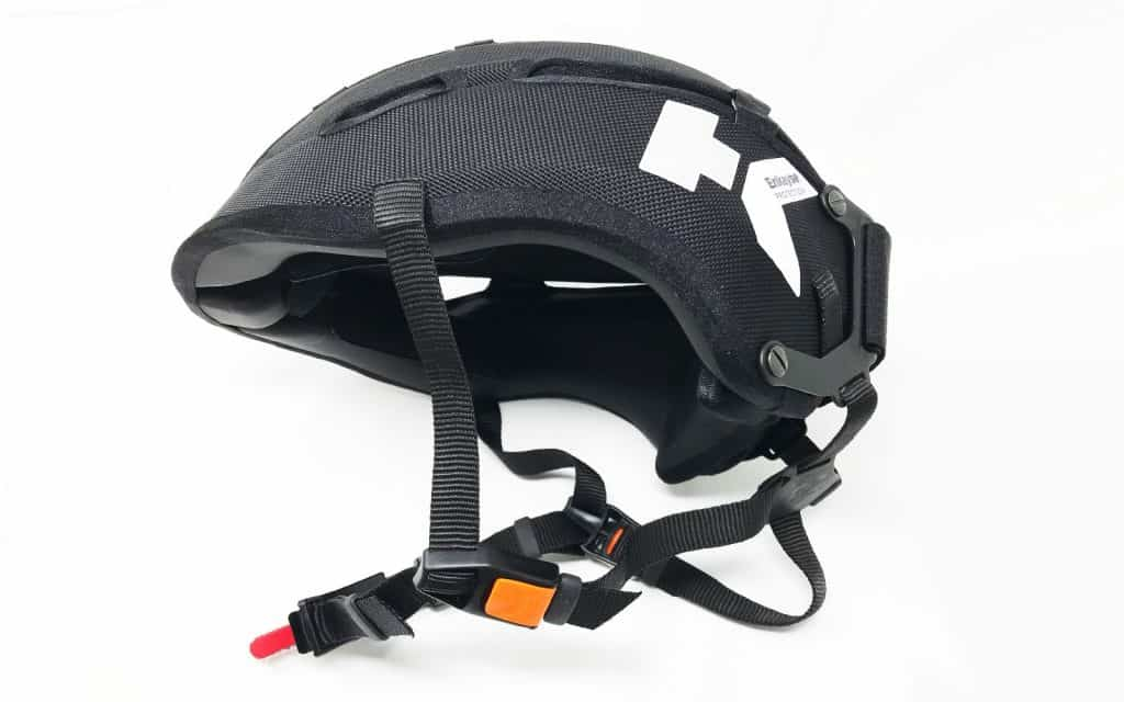 Hedkayse-One helmet in black side view showing Quick-release Adjustable Ratchet Chin-strap (QARC) buckle