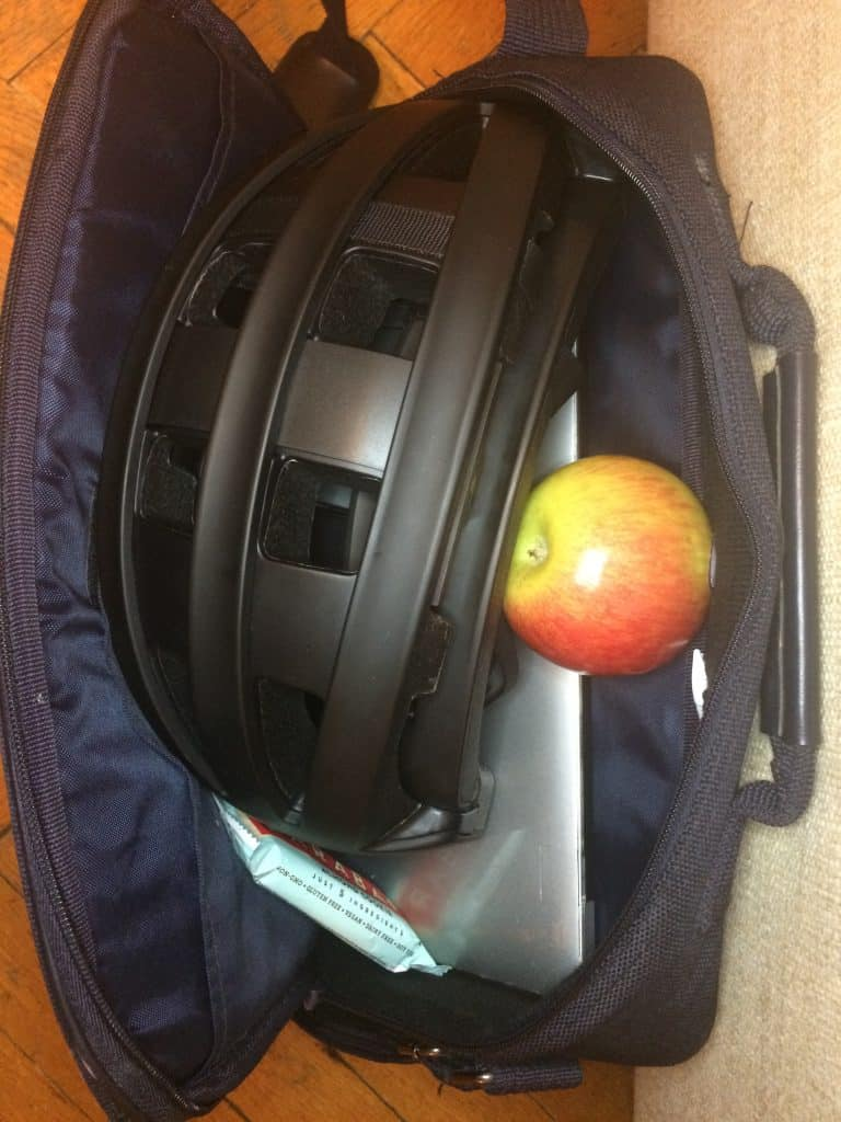 Fend folding helmet in briefcase with laptop and snack