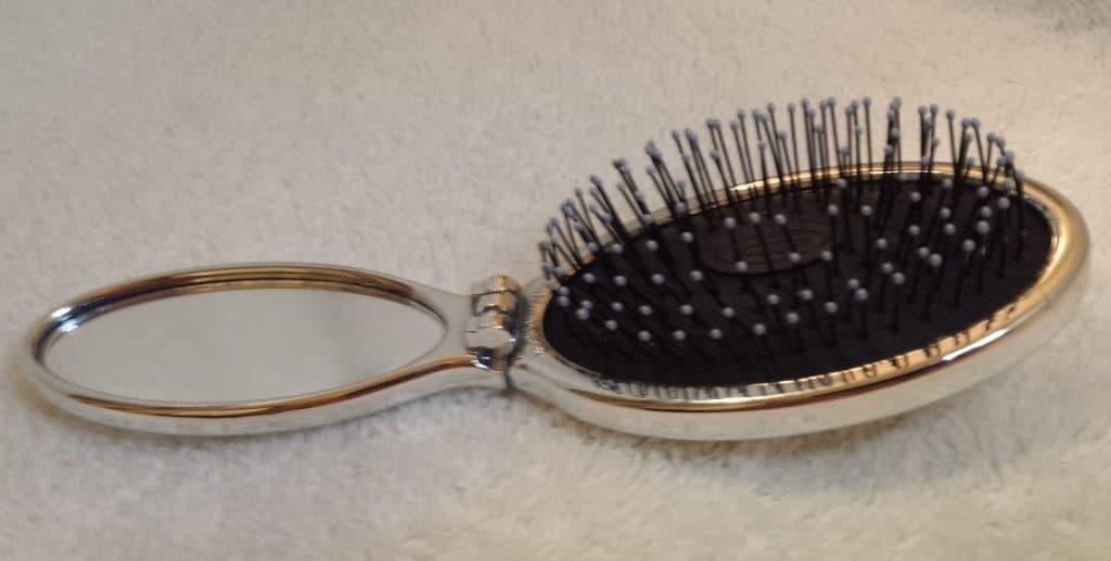 Wet Brush in silver lying flat open