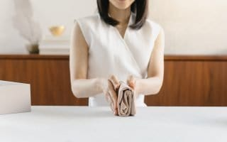 Marie Kondo showing a folded shirt